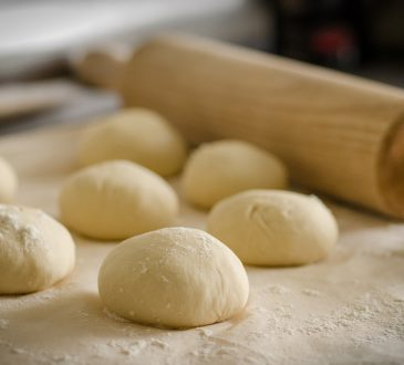 Balls of dough and a rolling pin