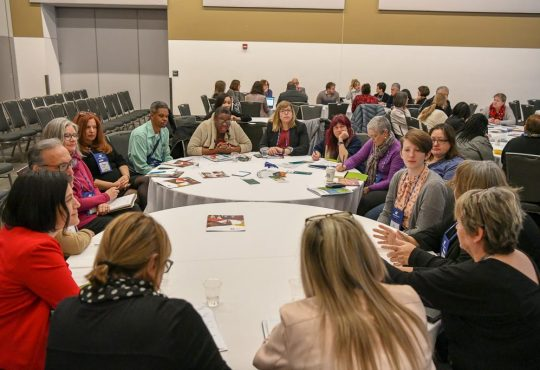 people sitting at round tables at CERIC's Cannexus19 conference