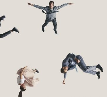 people falling on beige background