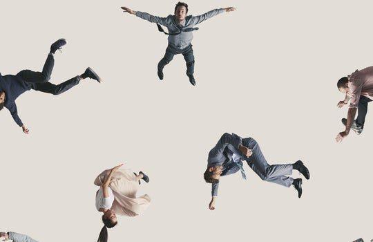 people falling on beige background