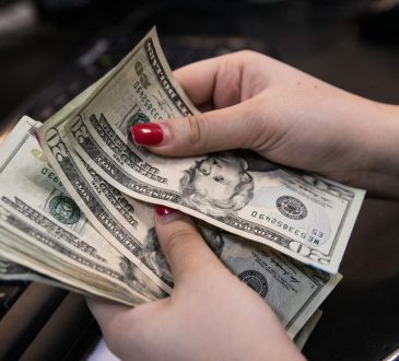 woman's hands counting money