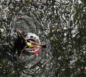 person floating on tube in water