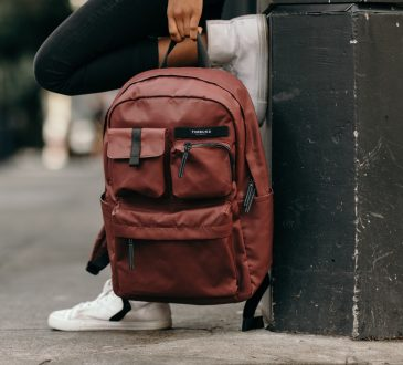 person holding backpack