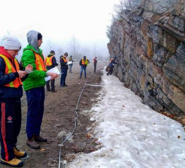 Brock students Matthew Deven, left, and Brendan Llew-Williams examine rock formations in northern Ontario during a fourth-year Earth Sciences course focused on advanced structural geology.