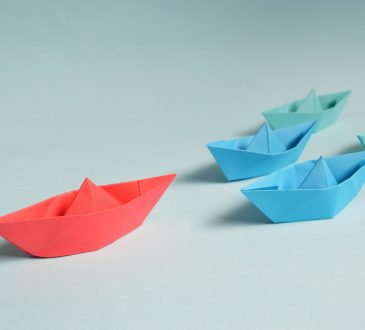 paper boats in a lineup