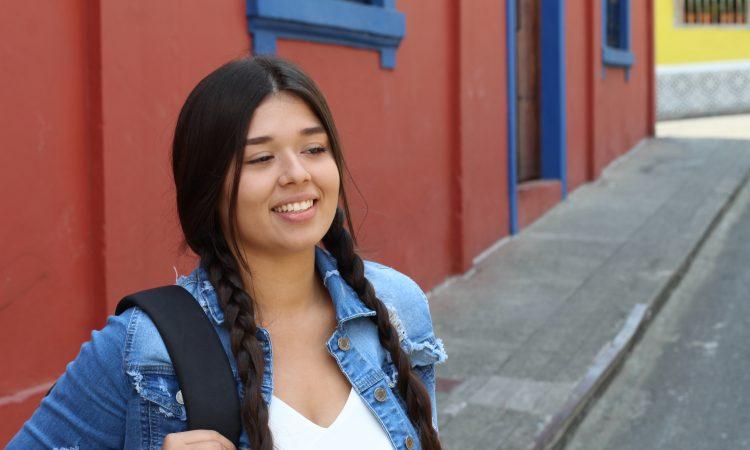 Teen girl wearing backpack