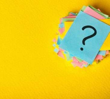 sticky notes with question mark on top