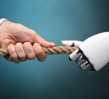 Businessperson And Robot Playing Tug Of War