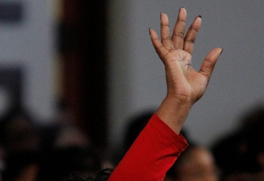 black woman raising hand