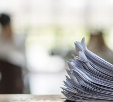 stack of papers on table