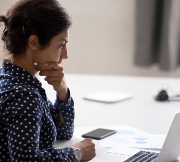 woman at desk looking concerned