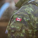 canadian soldier shoulder in camo with canadian flag