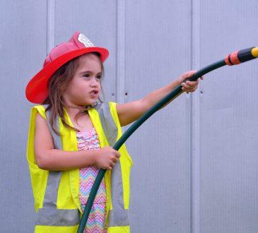 little girl wearing fireman costume