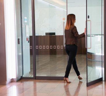 woman walking out of office
