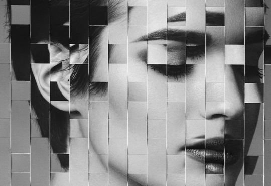 black and white photo of woman broken down into pixels