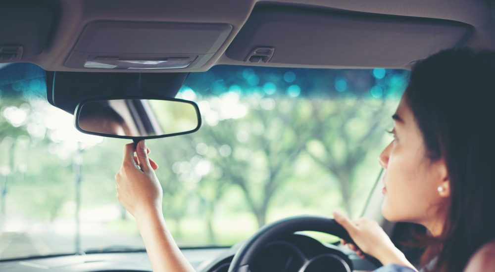 woman checking rearview mirror