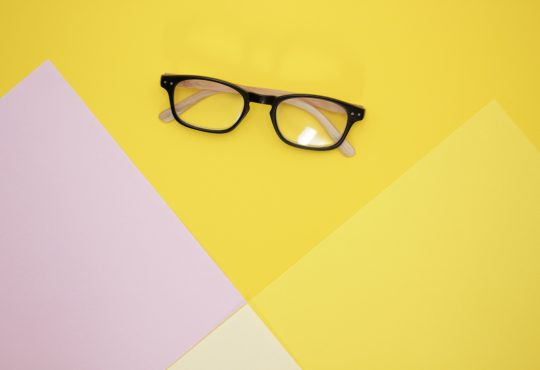 pair of glasses on yellow backdrop