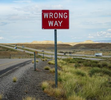 sign reading wrong way on roadside