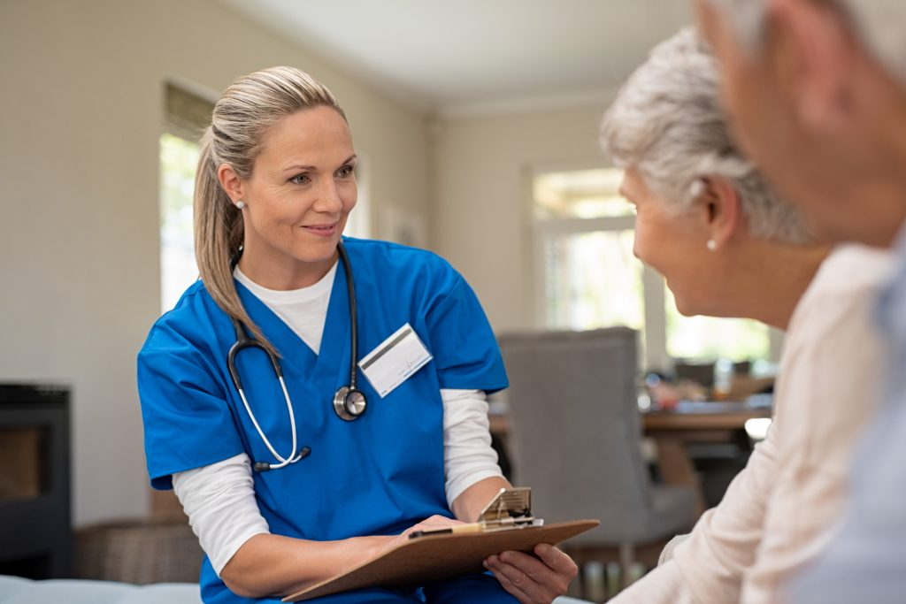 nurse talking to senior patients