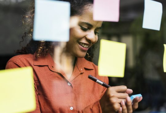 woman brainstorming with sticky notes