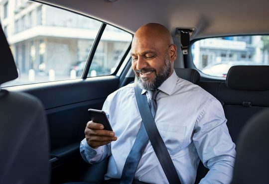 businessman in car on cellphone