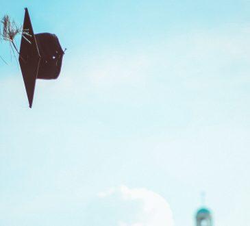 graduation cap flying through the air
