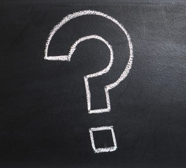 question mark in chalk on blackboard