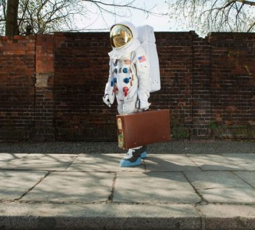 astronaut carrying briefcase