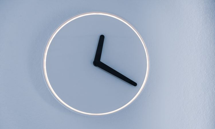 modern clock on blue wall