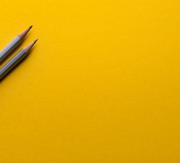 grey pencils on yellow background