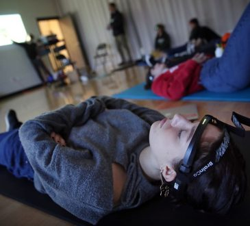 Student meditating with tracker band on forehead