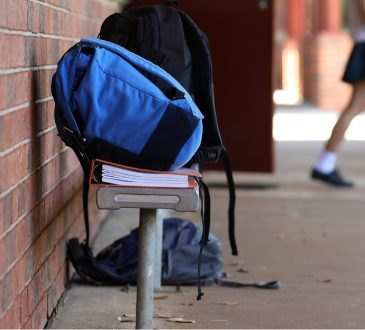 backpack on bench at high school