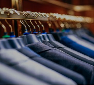 suit jackets hanging on rack