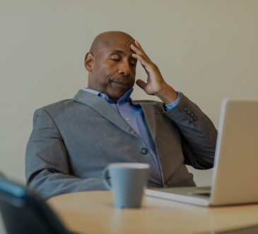 stressed man sitting at desk