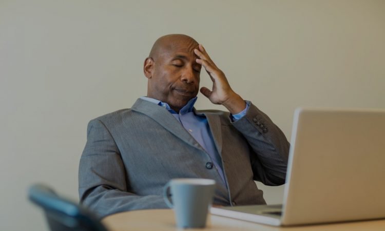stressed man sitting at desk