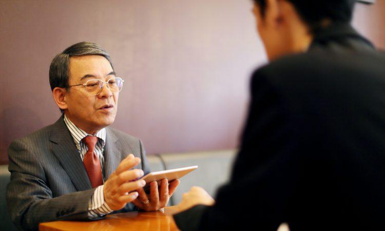 older worker in job interview