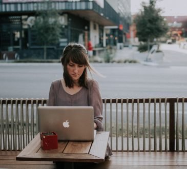 woman working on laptop on patio
