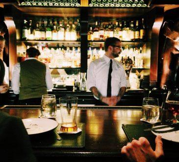 bartender standing behind bar
