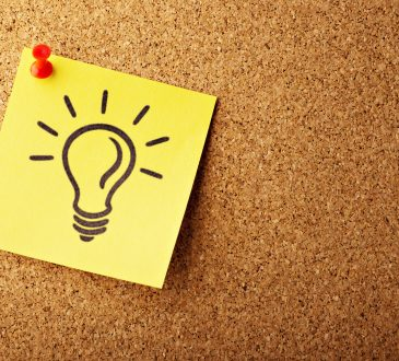 light bulb drawn on post-it pinned to bulletin board