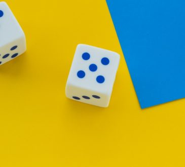 dice on bright yellow background