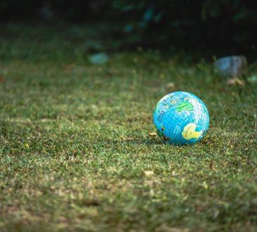 globe sitting on grass