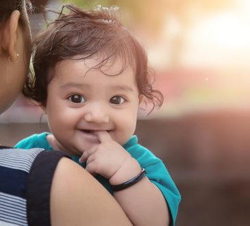 Young Indian Mother with her Loving Baby Girl Daughter
