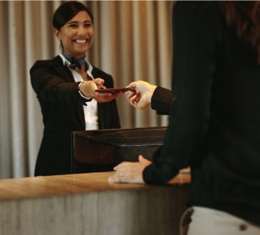 Woman working at hotel desk