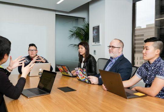 People sitting in board room in office