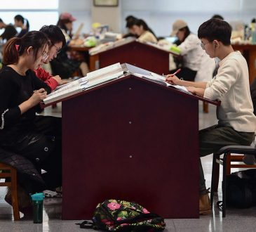 This photo taken on November 26, 2019 shows university students preparing for the upcoming National Postgraduate Entrance Exam (NPEE) at a library in Shenyang in China's northeastern Liaoning province.