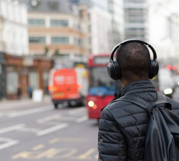 person wearing headphones while walking