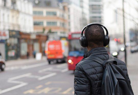 person wearing headphones while walking