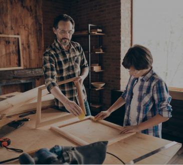 dad and son doing woodworking