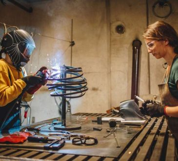women welding in shop