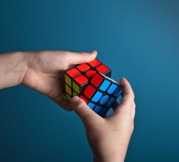 person working on rubik's cube